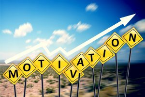 """Highway signs spelling out word """"motivation"""" with upward sloping arrow signifying increase"""