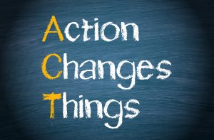 Sin with the words Action Changes Things - increasing confidence through action