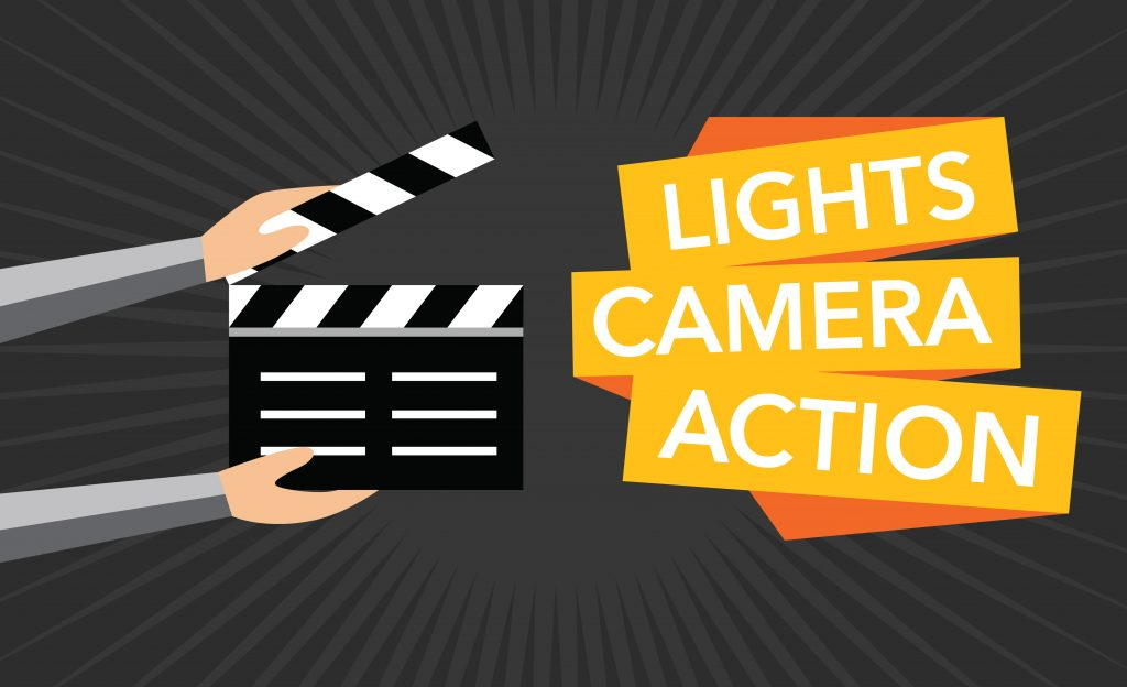 Photos of director's board stating Lights Camera Action